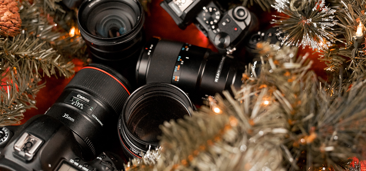 Canon Lenses and Cameras with Holidays Tinsel